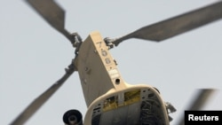 A U.S. Air Force CH-47 Chinook helicopter takes off from Camp Nathan Smith in Kandahar City on May 11.