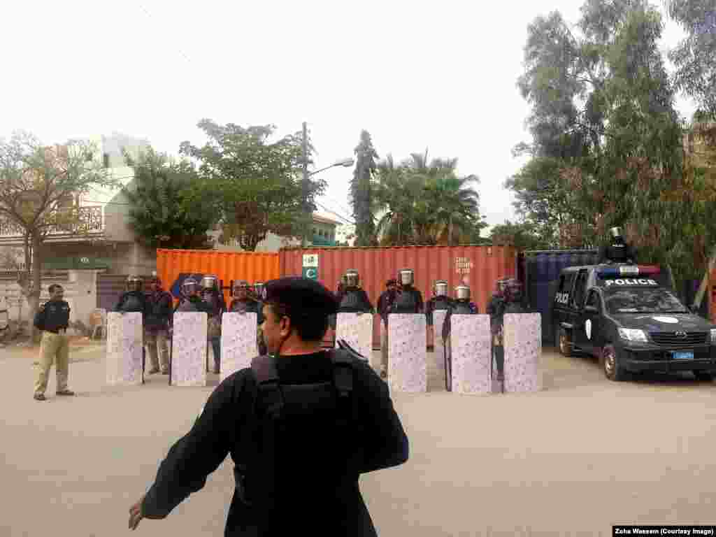 """Karachi police officers guard the roads leading to the French Consulate after a protest against the French satirical magazine """"Charlie Hedbo"""" turned violent in January."""