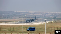Turkey - A Hercules C-130 military aircraft maneuvres on the runway at Incirlik Air Base, in the outskirts of the city of Adana, southeastern Turkey, on July 28, 2015