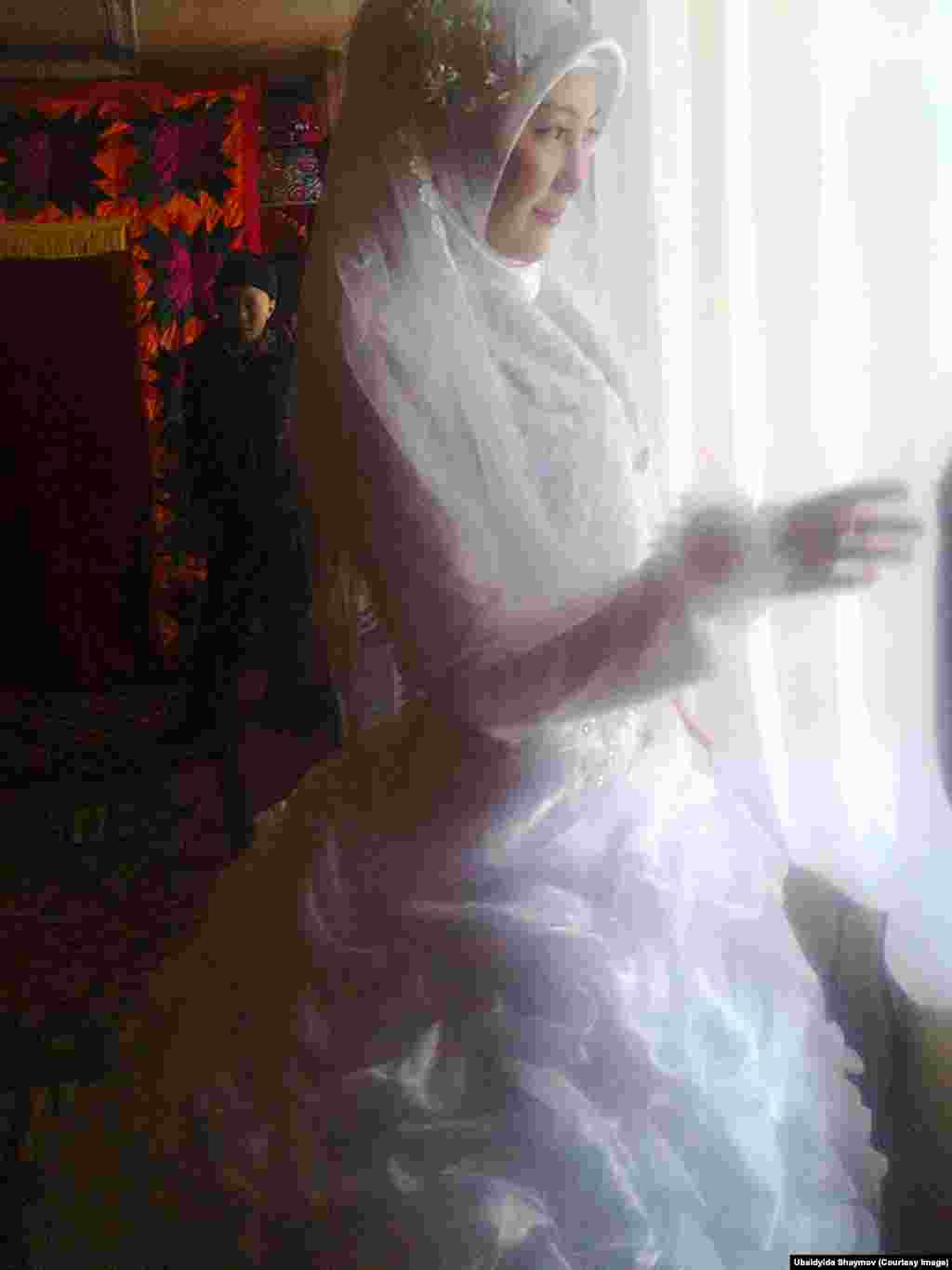 Palmira, a language teacher, looks out of a window before her wedding.