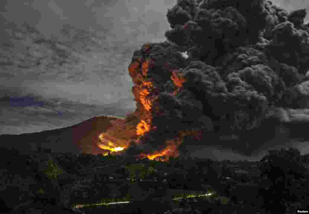 Mount Sinabung erupts as seen from Tiga Pancur village in Indonesia's North Sumatra Province. (Reuters/YT Haryono)