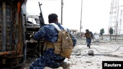 В районе боевых действий в иракском городе Мосул.