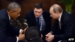 Russian President Vladimir Putin (right) meets with U.S. President Barack Obama on the sidelines of the G20 summit.