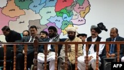 Members of the Loya Jirga listen during the first day of a four-day meeting of around 2,500 Afghan tribal elders and leaders in Kabul on November 21.