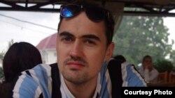 Крис Риклтон, France Press агенттігінің тілшісі