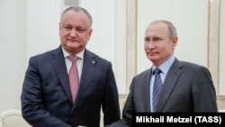 Russian President Vladimir Putin (right) meets with his Moldovan counterpart, Igor Dodon, at the Kremlin in Moscow in January.