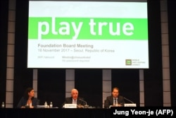 World Anti-Doping Agency President Craig Reedie (center) speaks as WADA Director-General Olivier Niggli (right) looks on during a press conference after WADA's Foundation Board meeting in Seoul on November 16.