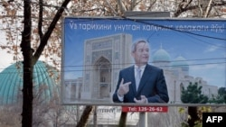 FILE: A giant election poster of President Islam Karimov.