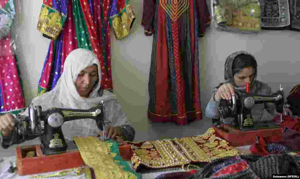 Women sew at the Handicraft Benzes shop.