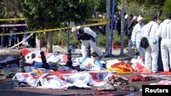 Turkey -- Police forensic experts examine the scene following explosions during a peace march in Ankara, 10Oct2015
