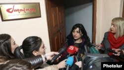 """Armenia -- Taguhi Tovmasian, a parliament deputy and the founder of """"Zhoghovurd"""" daily, speaks to reporters at the entrance to its offices, Yerevan, December 19, 2019."""