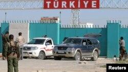 На границе Сирии и Турции. 25 июня 2015 года.