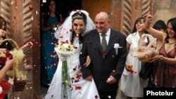 Armenia - A newlywed couple emerges from a church.