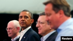 U.S. President Barack Obama (second from left), with British Prime Minister David Cameron (right), European Council President Herman Van Rompuy (left), and European Commission President Jose Manuel Barroso at the G8 summit in Enniskillen, Northern Ireland.