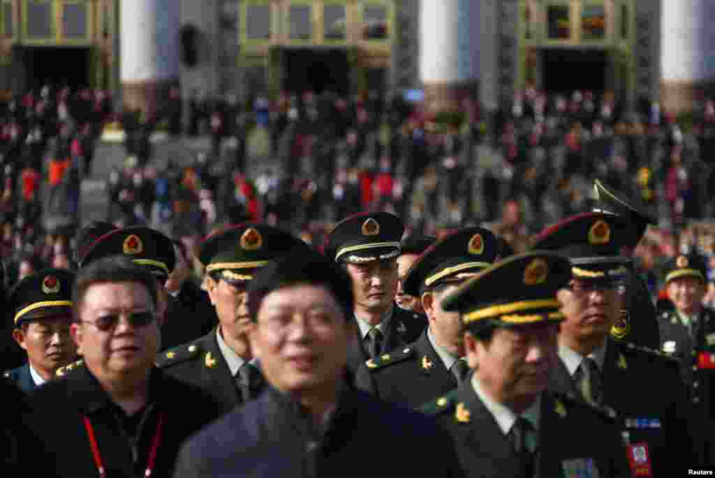 Military delegates leave the Great Hall of the People after the opening ceremony.