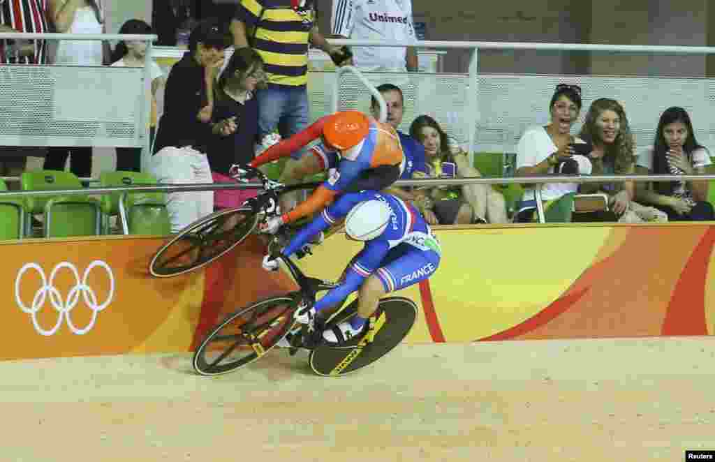 Laurine van Riessen of the Netherlands (top) and Virginie Cueff of France compete during women's keirin second round of the track-cycling events.