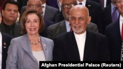 Afghan President Ashraf Ghani (right) and U.S. House Speaker Nancy Pelosi pose for a photo in Kabul on October 20.