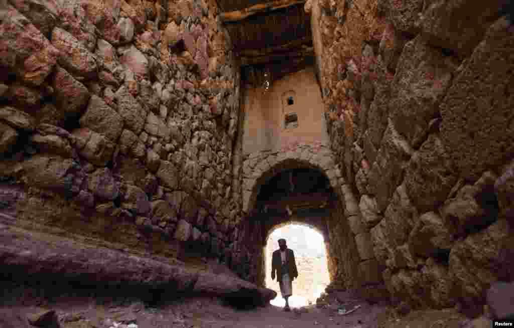A man walks in an alley in the village of Al-Gorza Hamdan, northwest of the Yemeni capital, Sanaa. (Reuters/Mohamed al-Sayaghi)