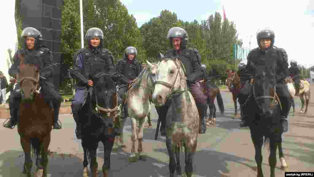 Mounted police patrol on a central square in Bishkek