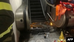 This photo, released by the Italian fire and rescue service, shows the scene at the bottom of the escalator after the injured had been taken to the hospital.