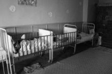 Children confined in cribs at Sasca Mica Rehabilitation Center, 2005