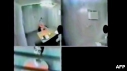 A video grab released by lawyers for Canadian Omar Khadr show him being questioned by Canadian officials at the U.S.-run detention facility at Guantanamo Bay.