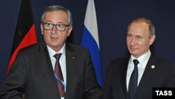 Еврокомиссия президенти Жан-Клод Юнкер ва Россия президенти Владимир Путин.