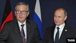 Глава Еврокомиссии Жан-Клод Юнкер (слева) и президент России Владимир Путин. Иллюстративное фото.