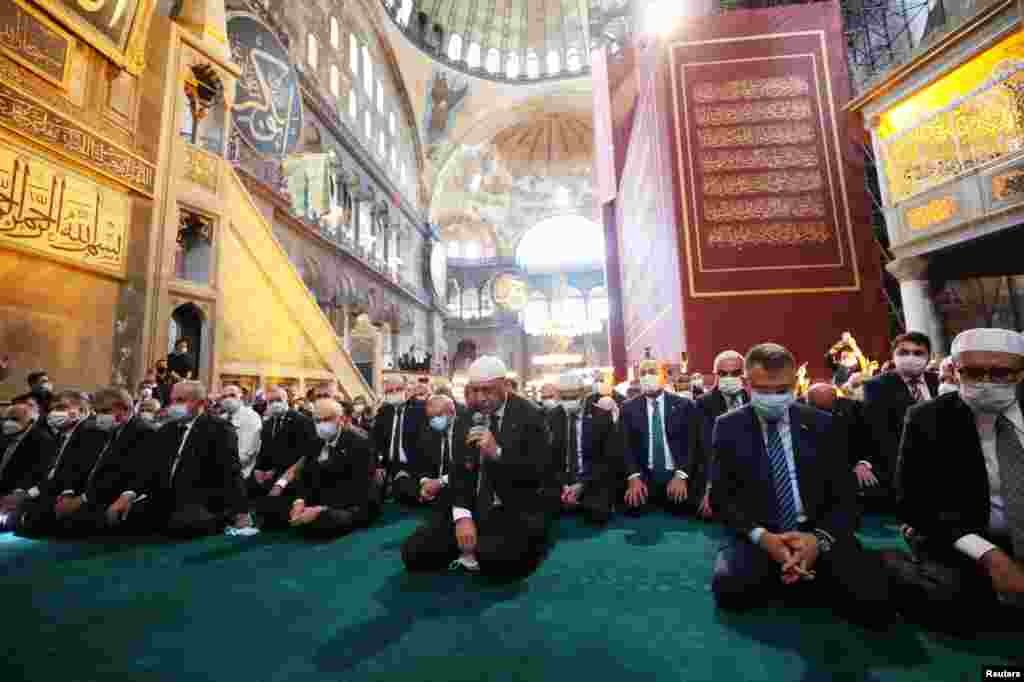 Turkish President Tayyip Erdogan (center) attends Friday prayers in the former cathedral, which is now called Hagia Sophia Grand Mosque.