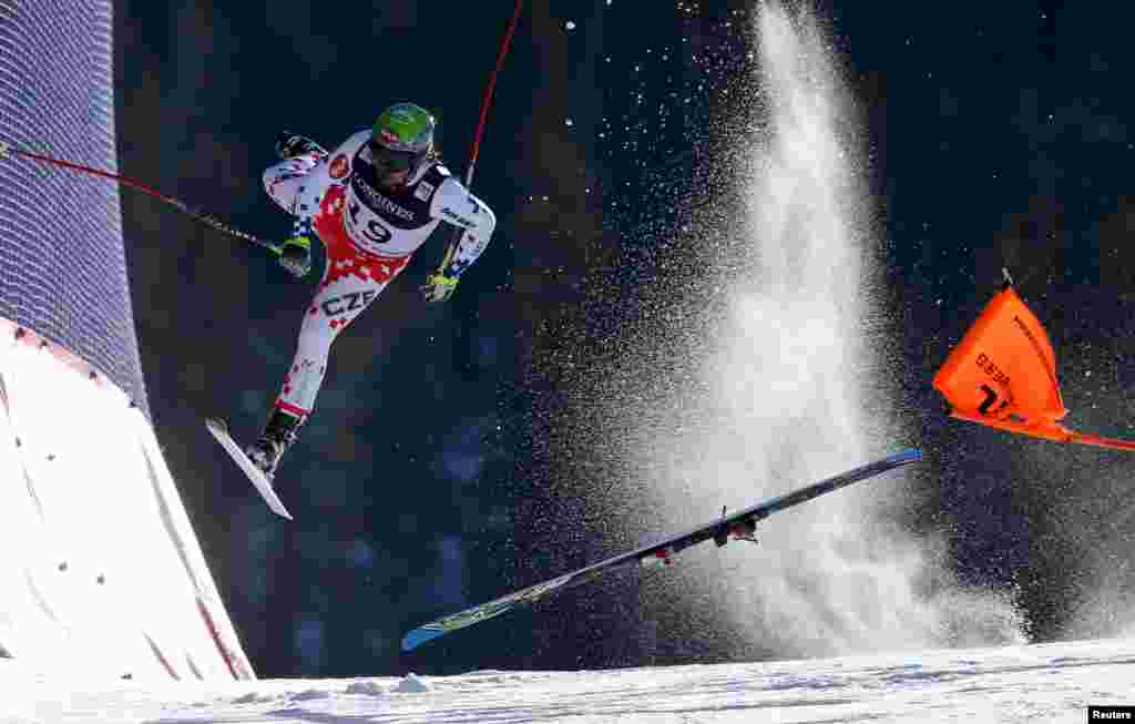 First Prize Singles in the Sports category was won by Austrian photographer Christian Walgram for his image of Czech skier Ondrej Bank crashing at speed while competing in the FIS World Championships. (February 8, 2015)