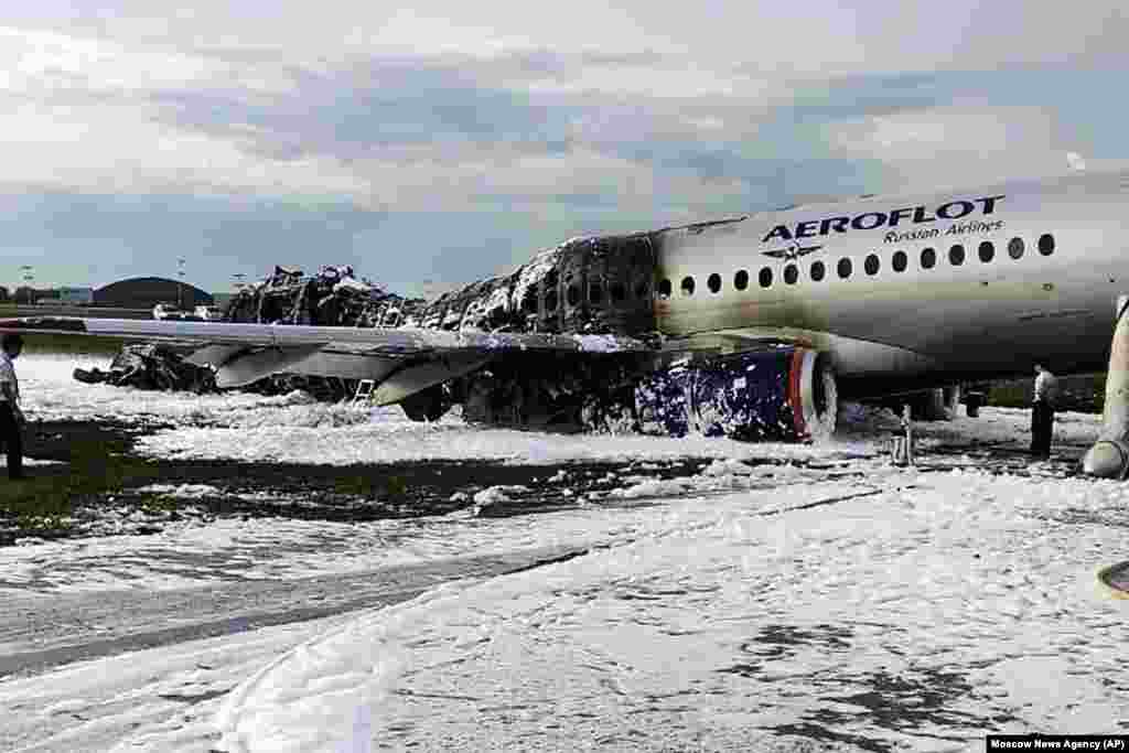 An Aeroflot Sukhoi SSJ100 aircraft is covered in fire-retardant foam after an emergency landing in Sheremetyevo airport in Moscow on May 5. Forty-one passengers and crew members died, officials said. (Moscow News Agency photo via AP)