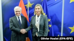 BELGIUM -- EU foreign policy chief Federica Mogherini (R) welcomes Armanian Foreign Minister Edward Nalbandian in Brussels, February 21, 2018