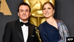 Former NASA scientist Firouz Naderi and engineer/astronaut Anousheh Ansari pose with the Best Foreign Language Film award for The Salesman on behalf of director Asghar Farhadi at the Oscars on February 26.