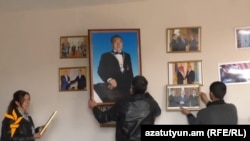 Armenia - Pictures of Kazakhstan's President Nursultan Nazarbayev are removed from a public library in the village of Harich, 18Apr2016.