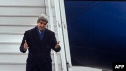 Ukraine -- US Secretary of State John Kerry gestures as he arrives at the International Airport in Kyiv, March 4, 2014