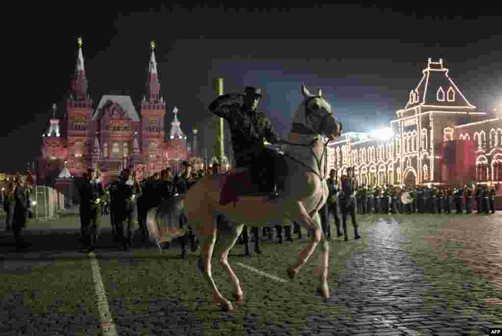 Also preparing for Victory Day celebrations, a Turkmen soldier rides a white Akhel-Teke horse during a parade rehearsal on Red Square in Moscow. Photo by Michael Eckels for AFP