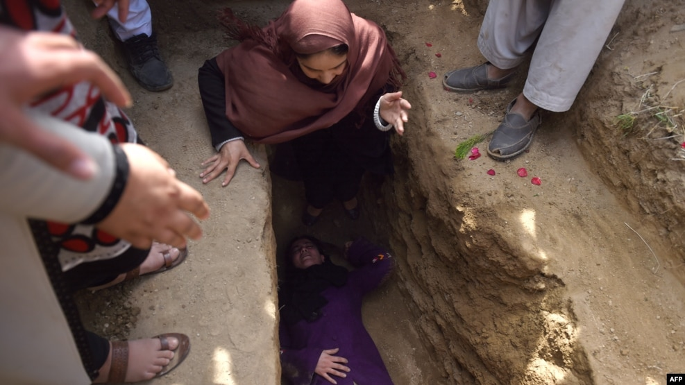 Violence against women remains a major issue in Afghanistan. File photo of Afghan civil society activist women weep and lie on the grave of Farkhunda, 27 after she was lynched by an angry mob in central Kabul on March 22.
