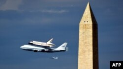 """The space shuttle """"Discovery,"""" sitting atop NASA's 747 shuttle carrier aircraft, flies over the Washington Monument."""