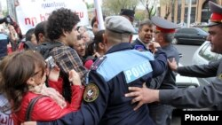 Armenia - Riot police scuffle with young activists of the opposition Armenian National Congress demonstrating outside the Yerevan Mayor's Office, 19Apr2013.