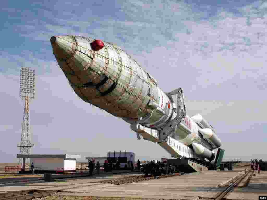 A Proton M carrier rocket with a Nimiq 5 satellite makes its way to the Baikonur launch pad in September 2009.