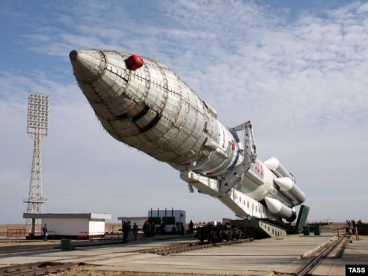 A Proton M carrier rocket with Nimiq 5 satellite is transported to its launch pad at Baikonur cosmodrome.