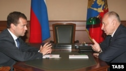 Russian President Dmitry Medvedev (left) meets with Daghestan's Mukhu Aliyev in Sochi in 2008.