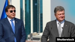 Former Georgian President Mikheil Saakashvili (left) was brought in by Ukrainian President Petro Poroshenko (right) to clean up Odesa, but many feel that he has made scant progress on that score. (file photo)