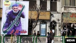 People walk past a billboard in Tehran for the upcoming parliamentary elections in Iran on March 2.