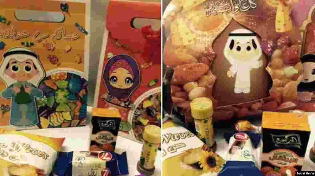 Поздравления с праздником на детских открытках, рядом лежат коробки со сладостями