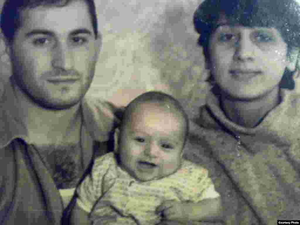 "Iveri Kurashvili, his wife Manana Ambalia, and their eldest son Giorgi as a baby. - The captain of the ""Vasilios N,"" Iveri Kurashvili, grew up in the Georgian port city of Poti, where ""nearly everyone is a sailor."" From the time he was in kindergarten, he says he knew he would be one as well. But when Giorgi decided to follow suit, his mother, Manana, objected at first. ""Iveri was at sea while my children were growing up,"" she says. ""He missed out on so many things."""