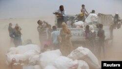 Refugjatët kurdë nga Siria duke u përpjekur për të kaluar në Turqi