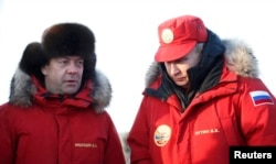 Russian President Vladimir Putin (right) and Prime Minister Dmitry Medvedev visit the remote Arctic islands of Franz Josef Land on March 29, 2017.