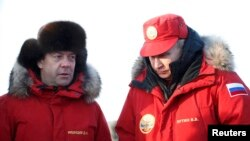 Russian President Vladimir Putin (right) and Prime Minister Dmitry Medvedev visit the remote Arctic islands of Franz Josef Land on March 29.
