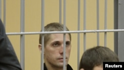 One of the condemned men, Uladzislau Kavalyou, in the dock during the Minsk trial